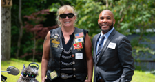female veteran standing with male director of housing and community investment
